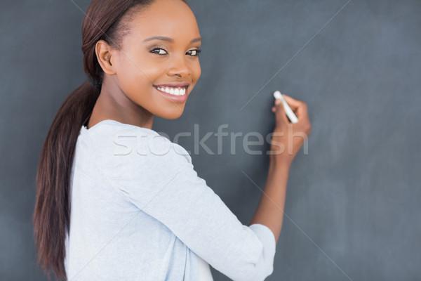 Afroamerikai nő mosolyog tart kréta osztályterem iskola Stock fotó © wavebreak_media