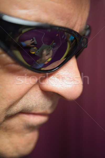 Stock photo: Man is wearing sun glasses at the casino