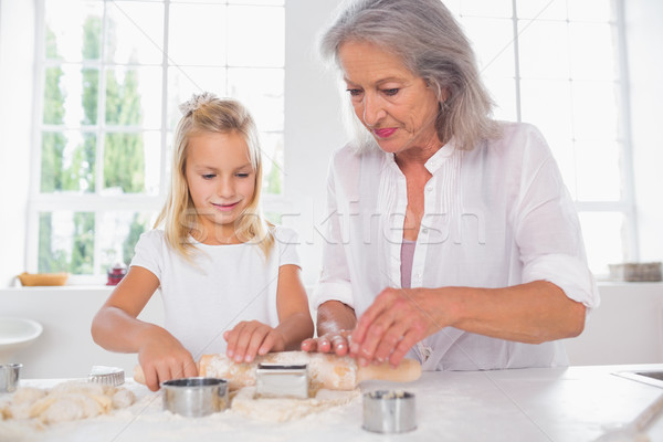 Grandmother and granddaughter making biscuits Stock photo © wavebreak_media