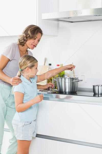 Mother teaching daughter how to cook Stock photo © wavebreak_media