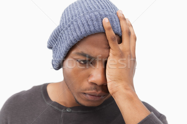 Depressed man in beanie hat Stock photo © wavebreak_media