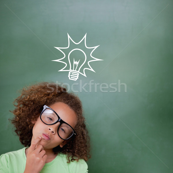 Composite image of cute pupil thinking Stock photo © wavebreak_media