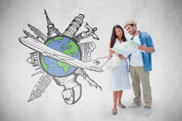 Composite image of happy hipster couple looking at map Stock photo © wavebreak_media
