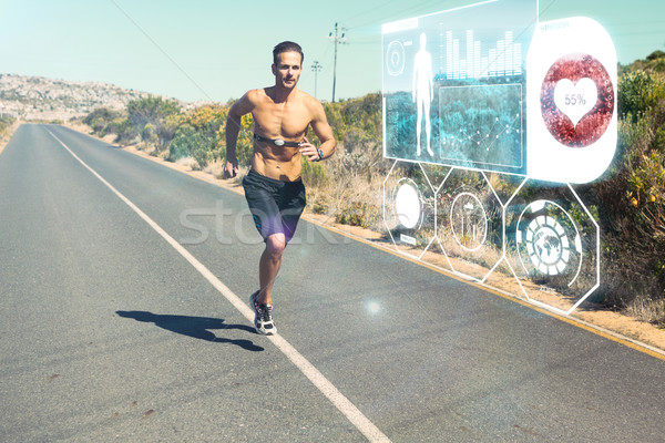 Composite image of athletic man jogging on open road with monito Stock photo © wavebreak_media