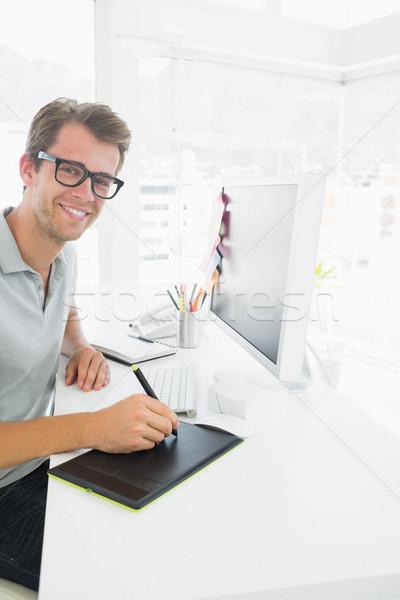 Yandan görünüş gündelik erkek fotoğraf editör grafik Stok fotoğraf © wavebreak_media