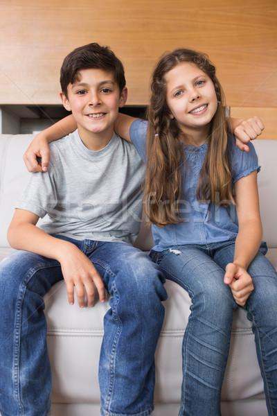 Portré mosolyog kicsi testvérek ül nappali Stock fotó © wavebreak_media