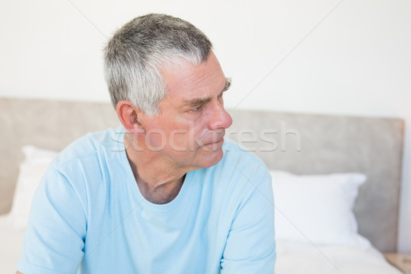 Senior man looking away on bed Stock photo © wavebreak_media