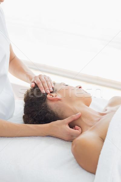 Relaxed woman receiving neck massage Stock photo © wavebreak_media
