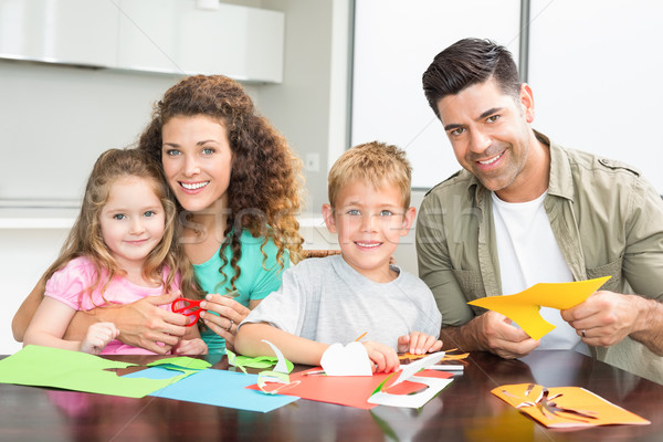Smiling family doing arts and crafts together at the table Stock photo © wavebreak_media