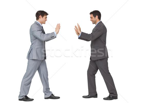 Business partner spingendo copia spazio bianco uomo suit Foto d'archivio © wavebreak_media