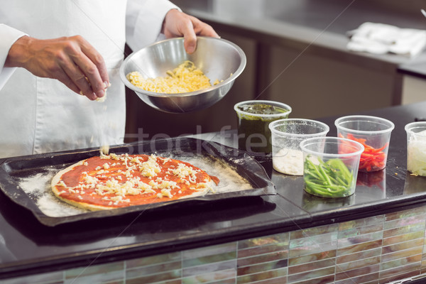 Mid section of a chef garnishing food in kitchen Stock photo © wavebreak_media