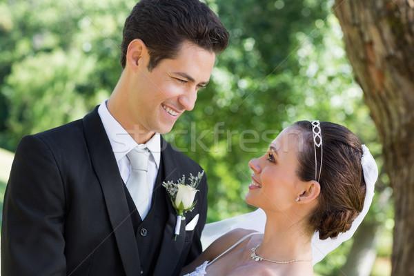 Bride and groom looking at each other in garden Stock photo © wavebreak_media