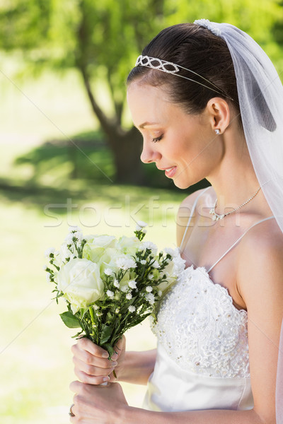 Shy bride holding bouquet in garden Stock photo © wavebreak_media