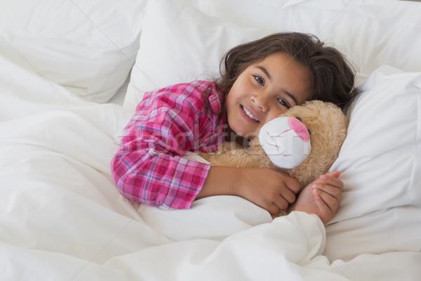 Portré mosolyog lány töltött játék pihen Stock fotó © wavebreak_media