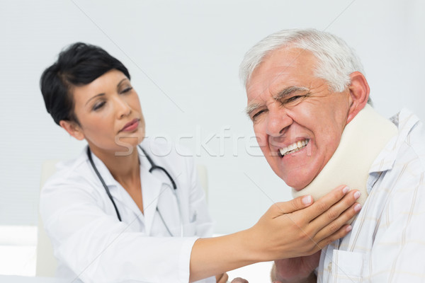 Female doctor examining a senior patients neck Stock photo © wavebreak_media