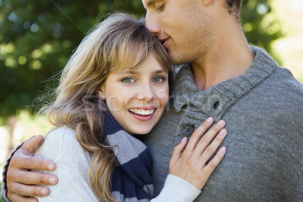 Cute woman smiling at camera with her boyfriend Stock photo © wavebreak_media