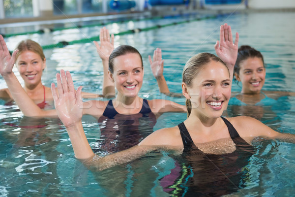 Gülen kadın uygunluk sınıf su aerobik Stok fotoğraf © wavebreak_media