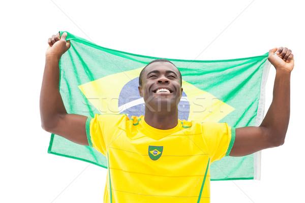 Boldog futball ventillátor éljenez tart zászló Stock fotó © wavebreak_media