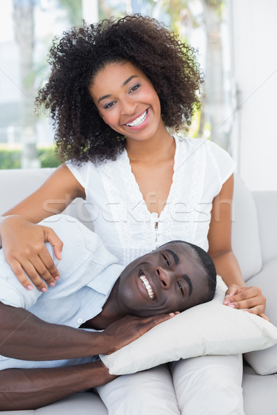 Stock photo: Attractive couple cuddling on the couch
