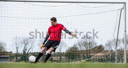 Futbolista amarillo pelota blanco hombre deporte Foto stock © wavebreak_media