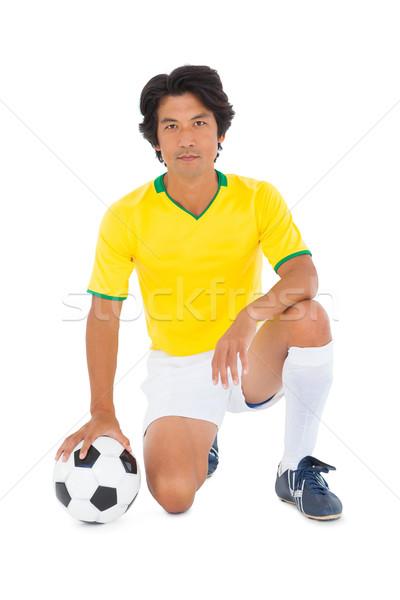 Futballista citromsárga térdel labda fehér férfi Stock fotó © wavebreak_media