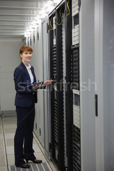 Technician working on servers using tablet pc Stock photo © wavebreak_media