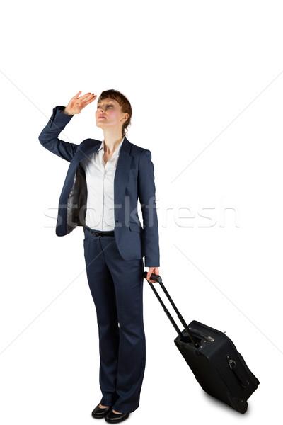 деловая женщина чемодан глядя белый бизнеса Сток-фото © wavebreak_media