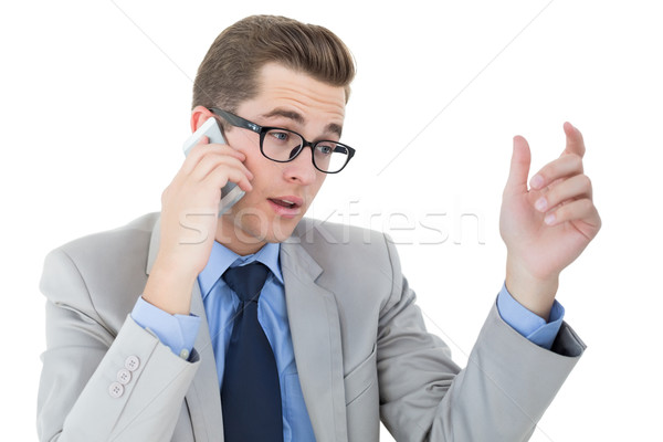 Nerdy businessman on a phone call Stock photo © wavebreak_media
