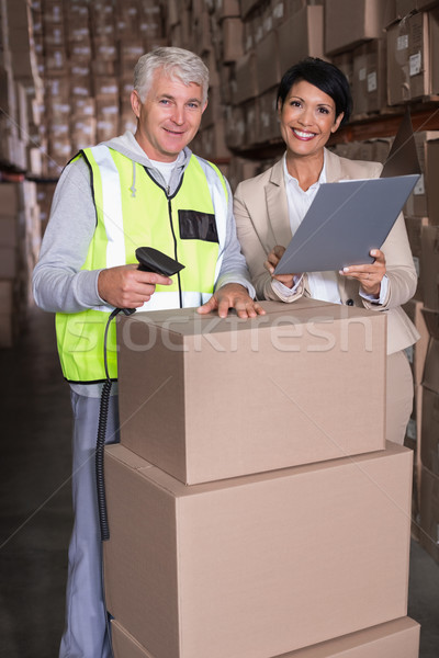 Warehouse worker scanning box with manager Stock photo © wavebreak_media
