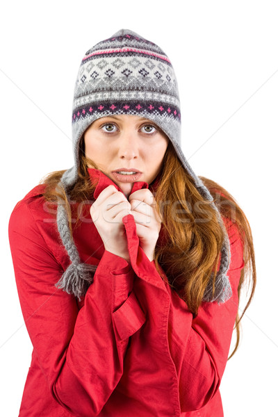 Cold redhead wearing coat and hat Stock photo © wavebreak_media