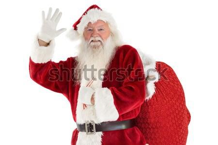 Padre Natale elenco bianco uomo sorridere Foto d'archivio © wavebreak_media