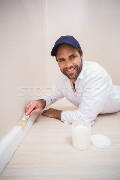 Painter painting the skirting boards Stock photo © wavebreak_media