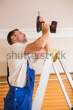 Bricoleur sans fil forage plafond maison Photo stock © wavebreak_media
