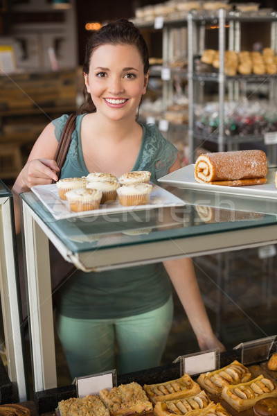 Pretty brunette smiling at camera Stock photo © wavebreak_media