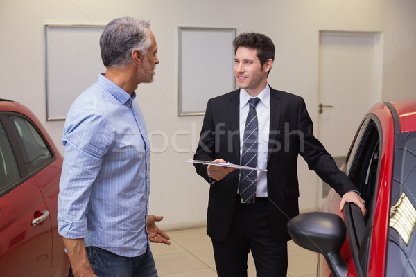 Smiling businessman speaking with his customer Stock photo © wavebreak_media