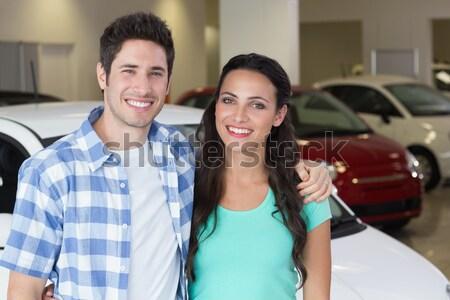 Smiling young couple receiving key Stock photo © wavebreak_media