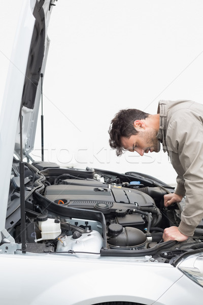 Stressed man looking at engine Stock photo © wavebreak_media