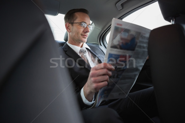 Focused businessman reading the newspaper Stock photo © wavebreak_media