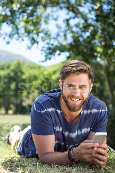 Jóképű hipszter telefon park boldog természet Stock fotó © wavebreak_media