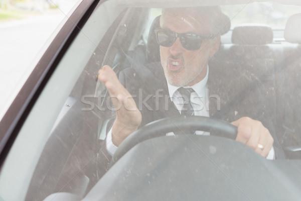 Nervous man sitting at the wheel  Stock photo © wavebreak_media
