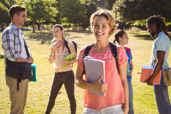 Szczęśliwy studentów na zewnątrz kampus kobieta Zdjęcia stock © wavebreak_media