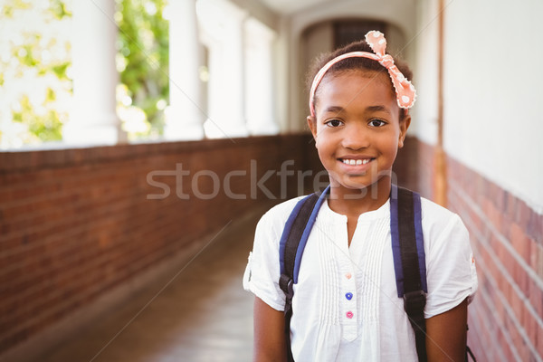 女の子 笑みを浮かべて 学校 廊下 肖像 かわいい ストックフォト © wavebreak_media
