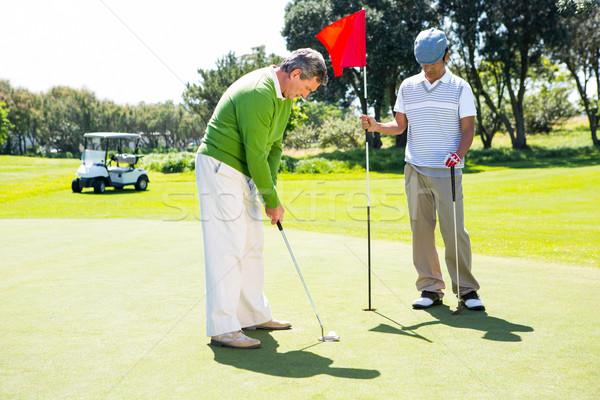 гольфист дыра флаг друга мяча Сток-фото © wavebreak_media
