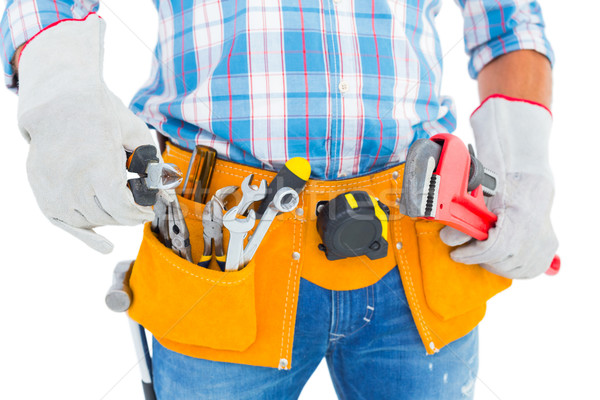 Midsection of handyman holding hand tools Stock photo © wavebreak_media