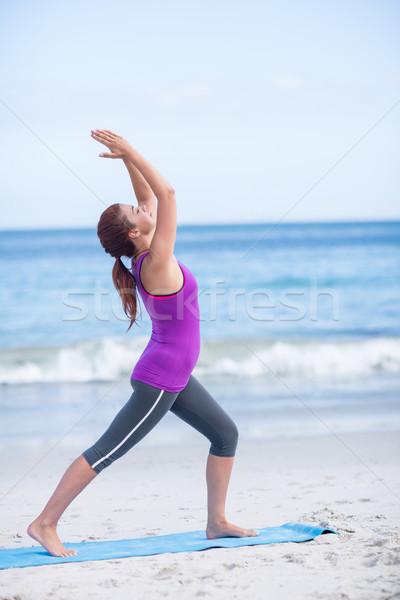 Brunette doing yoga on exercise mat Stock photo © wavebreak_media