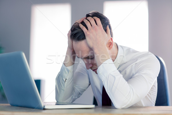 Worried businessman with head in hands Stock photo © wavebreak_media