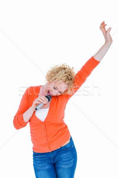 Happy pretty blonde singing in microphone  Stock photo © wavebreak_media