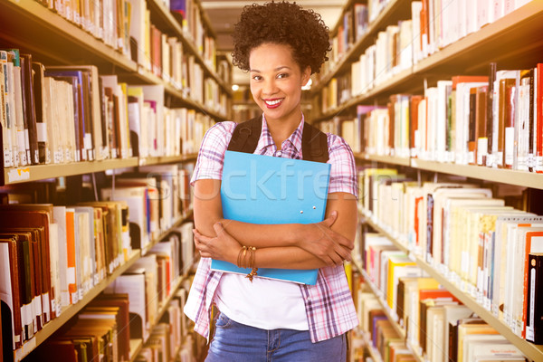 Composite image of casual young woman with folder in office Stock photo © wavebreak_media