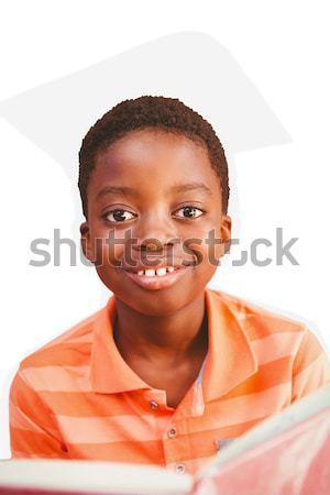 Cute boy showing red card Stock photo © wavebreak_media