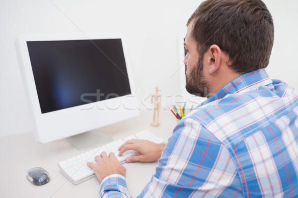 Lezser üzletember dolgozik asztal iroda üzlet Stock fotó © wavebreak_media